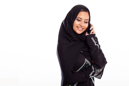 pretty young muslim woman talking on mobile phone photo
