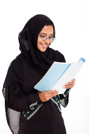 pretty female Muslim woman reading book isolated on white photo