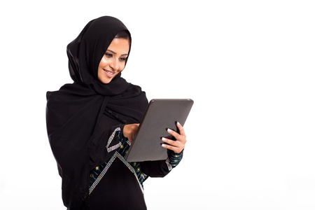 pretty modern Arabian woman with tablet computer isolated on white photo