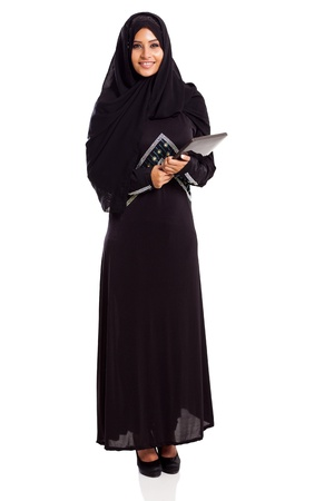 pretty Muslim woman with tablet computer isolated on white photo