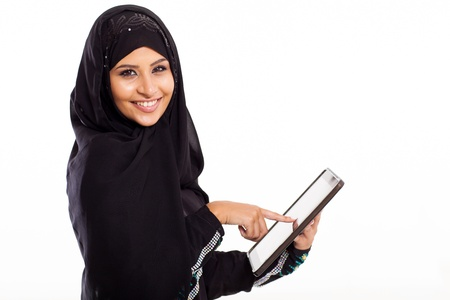 muslim: attractive Arabic woman using tablet computer isolated on white Stock Photo