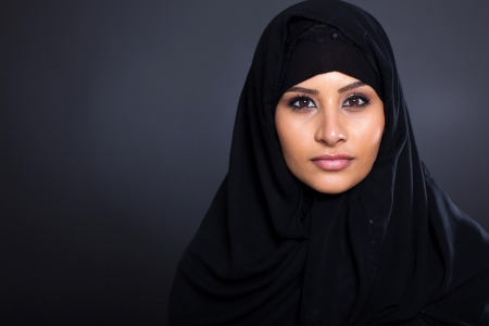 attractive Muslim woman on black background Stock Photo