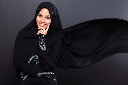 fashionable Arabian woman on black background photo