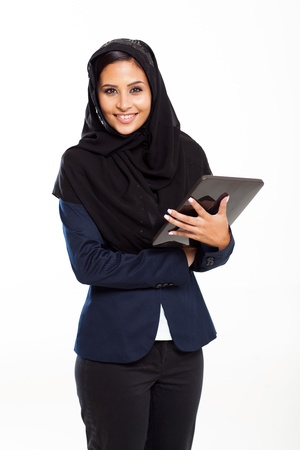 cute Arabian businesswoman with tablet computer isolated on white photo