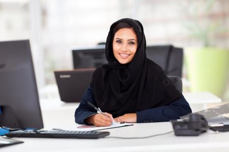 modern female Arabian office worker in office photo