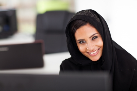 arabic woman: cute Muslim businesswoman working in modern office Stock Photo