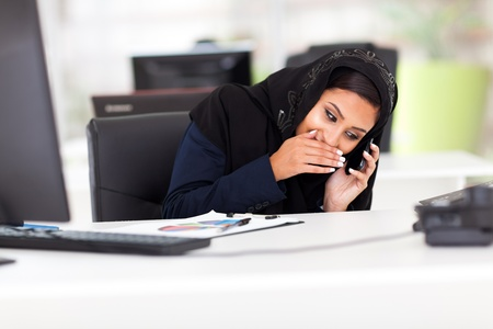 black lady talking: Arabian businesswoman taking a private call during working hour Stock Photo
