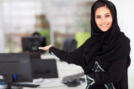 attractive young Arabian businesswoman presenting office photo