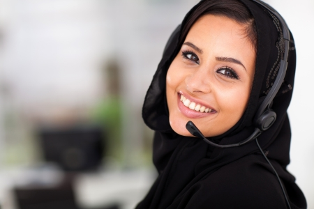 pretty Arabian call center operator closeup portrait photo