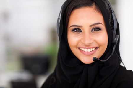 operators: beautiful middle eastern businesswoman with headphones closeup head shot
