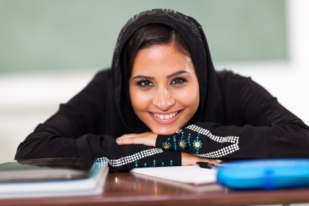 smiling Muslim female high school student in classroom photo