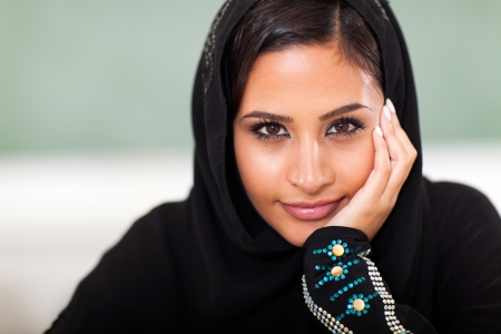 teen female Muslim high school student closeup portrait in classroom photo