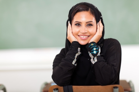 cute female Arabian university student in classroom photo