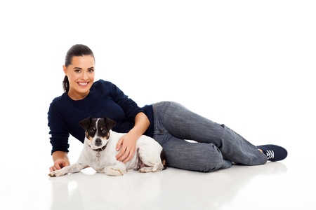 young woman lying with her dog photo
