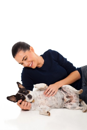 happy woman playing with her pet dog isolated in white photo