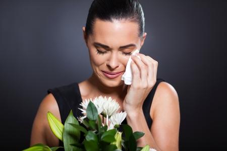 sad crying woman at funeral photo