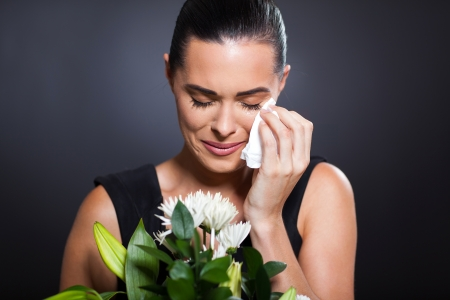 mourn: sad crying woman at funeral