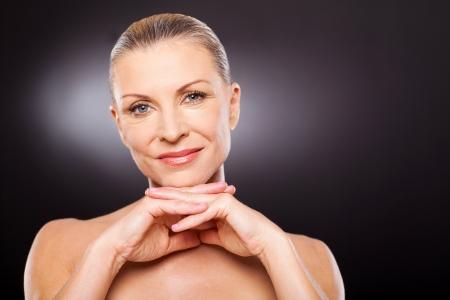 moderm: gorgeous moderm senior woman wearing makeup