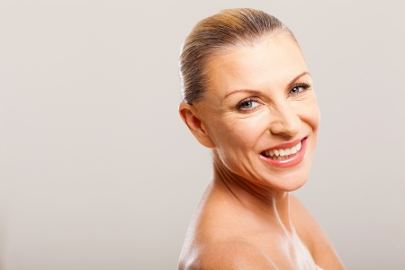 gorgeous mid age woman smiling against white background