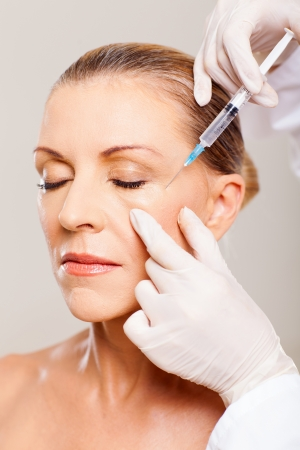 senior woman receiving plastic surgery injection on her face Stock Photo - 18661287