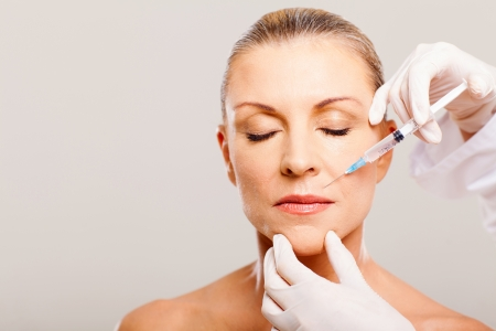 cosmetic injection to mature woman face Stock Photo - 18661232