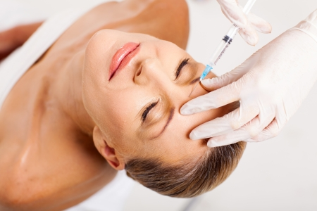 beautiful senior woman receiving cosmetic injection on her forehead Stock Photo - 18661280