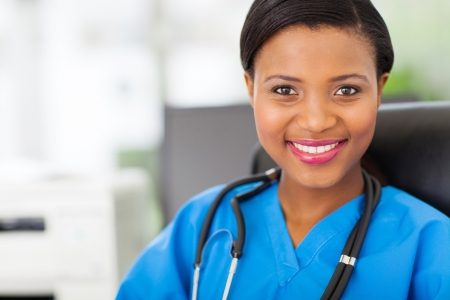 beautiful female african american medical nurse with stethoscope photo