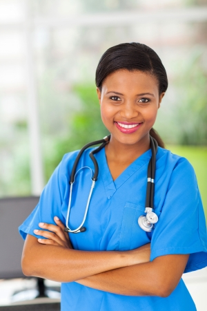 portrait of beautiful afro american female medical intern in modern office photo
