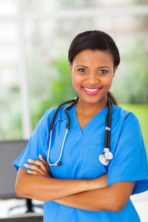 pediatric nurse: portrait of beautiful afro american female medical intern in modern office