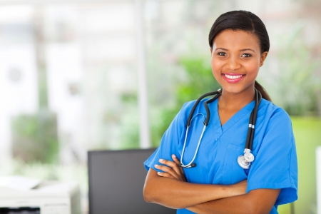 healthcare office: beautiful african american female pediatric nurse in modern office