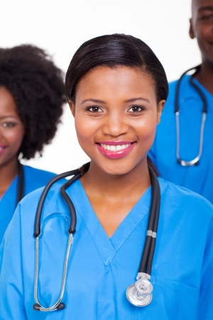 beautiful female african american nurse with colleagues  on background photo