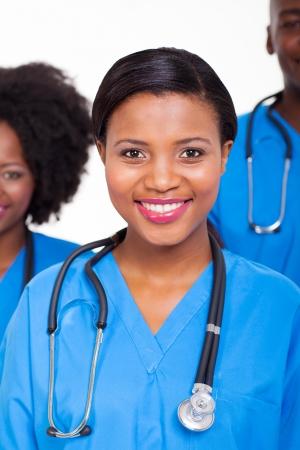 black nurse: beautiful female african american nurse with colleagues  on background