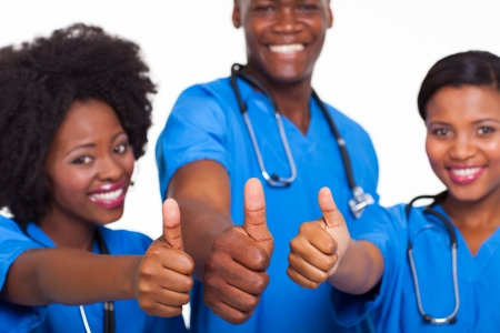 group of happy african american medical team thumbs up