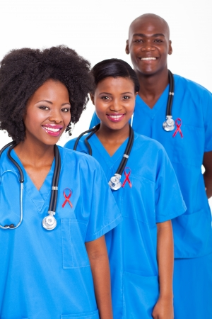 aids: group of african medical workers with red ribbon for HIV awareness Stock Photo