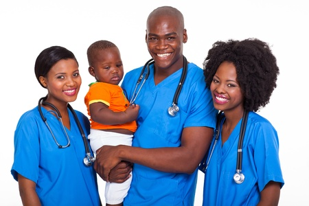 group of african pediatricians with baby boy isolated on white photo