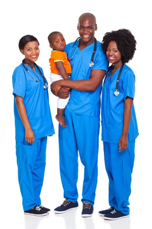 group of young african doctors with child isolated on white photo