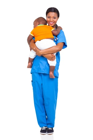 pretty african nurse carrying a child isolated on white photo