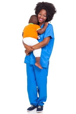 beautiful black paediatric nurse with child isolated on white photo