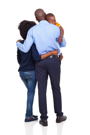 man back view: rear view of young african american couple carrying baby boy isolated on white Stock Photo