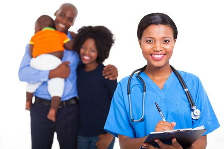modern doctor: beautiful female african american nurse with family patients on background Stock Photo