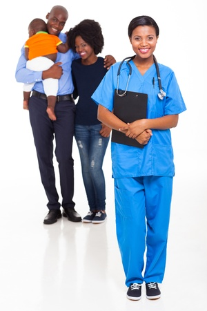 nurse clipboard: beautiful young black nurse with african family Stock Photo