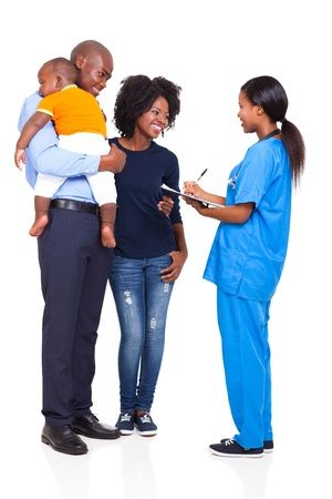 young female nurse chatting with african family isolated on white background photo