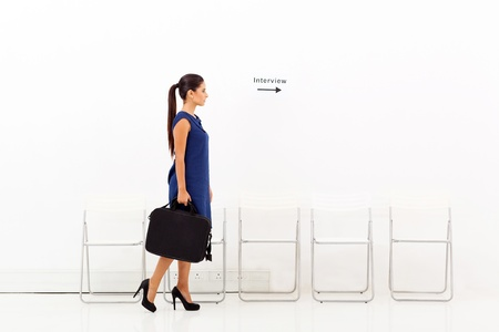 to go: young businesswoman going for job interview