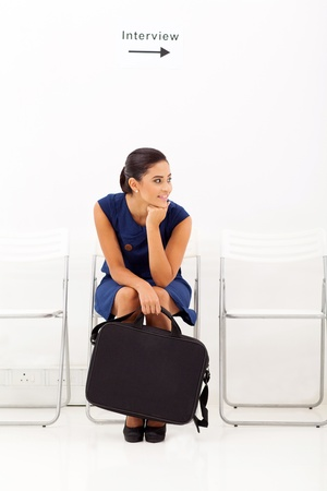 bored female applicant waiting for employment interview photo