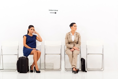 job vacancies: two beautiful female candidates waiting for job interview