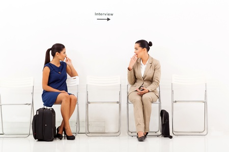 beautiful caucasian women chatting before employment interview photo