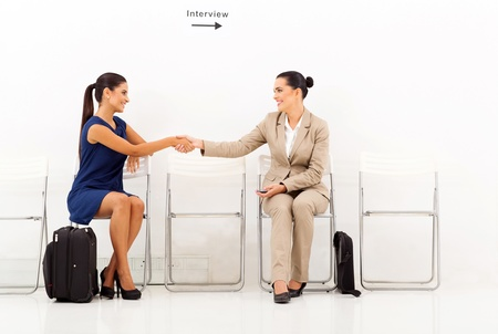 modern businesswomen greeting each other before the interview photo