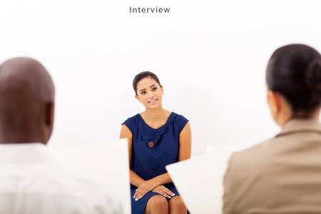 interviewing: young female applicant during job interview