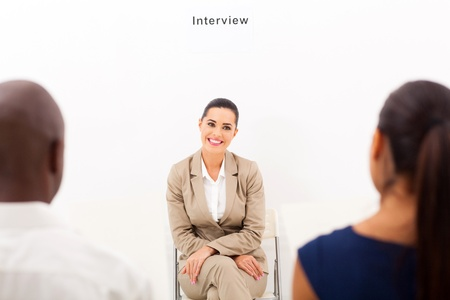 caucasian woman during employment interview with two human resouces personnel photo