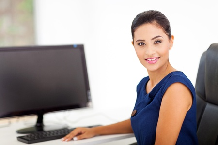 beautiful indian businesswoman in her modern office photo